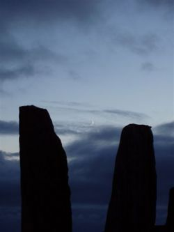The New Moon stands between two monoliths just before the Solstice Hour at 23.11pm on 20th June 2004.